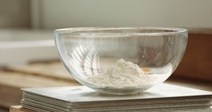 bowl with a flour in sunny kitchen