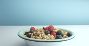 bowl with corn rings and berries healthy breakfast
