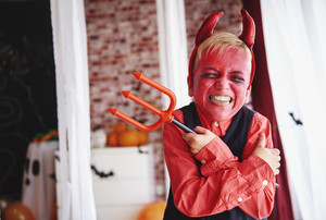 Boy in devil costume grimacing