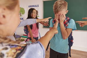 Boy is bullying by children at school
