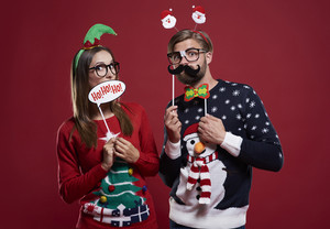 Boyfriend and girlfriend with Christmas masks