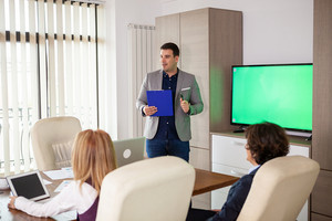 Business meeting and presentation in modern conference room for colleagues. Corporate development