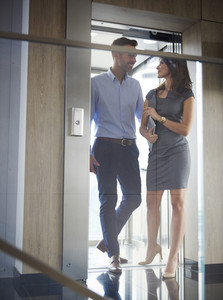 Business partners going out the elevator