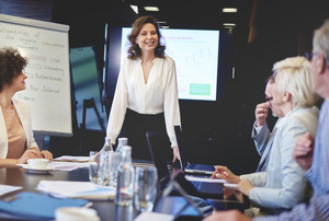 Business woman in conference room giving speech