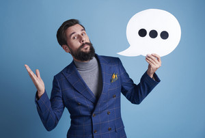 Businessman holding a speech bubble