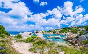 Cala Scilla place near Costa Serena with sandstone rocks in sea, Sardinia, Italy