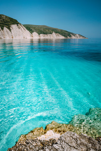 Calm turquoise azure emerald water of mediterranean sea surrounded by high white rocky cliffs. Summer beach vacation relaxation concept