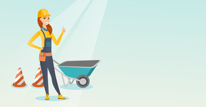 Caucasian builder showing thumb up while standing near wheelbarrow. Young builder in hard hat giving thumb up. Builder at work on construction site. Vector flat design illustration. Horizontal layout.