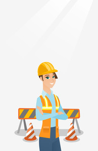 Caucasian builder standing on the background of construction site with road barriers. Builder standing with arms crossed. Confident builder in helmet. Vector flat design illustration. Vertical layout.