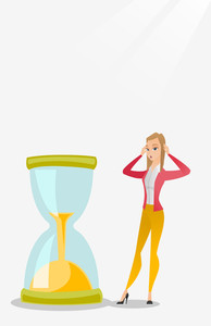 Caucasian business woman looking at hourglass symbolizing deadline. Business woman worrying about deadline terms. Time management and deadline concept. Vector flat design illustration. Vertical layout