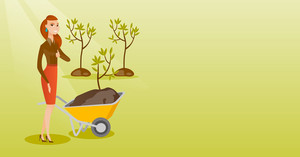 Caucasian female gardener with wheelbarrow on the background of newly planted trees. Young gardener pushing wheelbarrow with tree and dirt in park. Vector flat design illustration. Horizontal layout.
