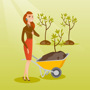 Caucasian female gardener with wheelbarrow on the background of newly planted trees. Young gardener pushing wheelbarrow with tree and dirt in the park. Vector flat design illustration. Square layout.