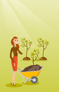 Caucasian female gardener with wheelbarrow on the background of newly planted trees. Young gardener pushing wheelbarrow with tree and dirt in the park. Vector flat design illustration. Vertical layout