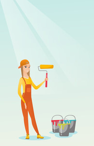 Caucasian female painter in uniform holding paint roller in hands. Young cheerful house painter at work. Smiling painter standing near paint cans. Vector flat design illustration. Vertical layout.