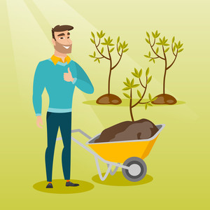 Caucasian gardener with wheelbarrow standing on the background of newly planted trees. Hipster gardener pushing wheelbarrow with tree and dirt in park. Vector flat design illustration. Square layout.