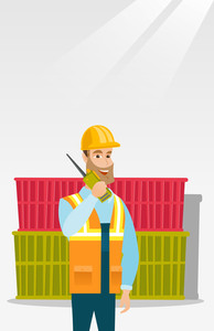 Caucasian port worker in hard hat talking on wireless radio. Port worker standing on cargo containers background. Port worker using wireless radio. Vector flat design illustration. Vertical layout.