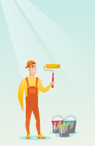 Caucasian smiling painter in uniform holding paint roller in hands. Young cheerful house painter at work. Happy male painter standing near paint cans. Vector flat design illustration. Vertical layout.