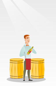 Caucasian waiter holding a bottle of wine. Young waiter with a bottle standing on the background of wine barrels. Waiter presenting a wine bottle. Vector flat design illustration. Vertical layout.