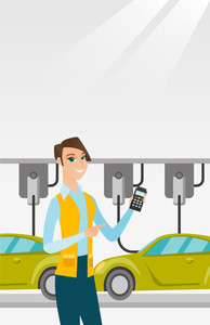 Caucasian worker of car factory. Young engineer at work at car factory. Worker controlling modern automated assembly line for cars. Car production. Vector flat design illustration. Vertical layout.