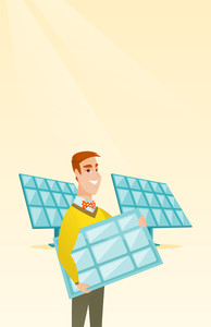 Caucasian worker of solar power plant holding solar panel in hands. Young man with panel in hands standing on the background of solar power plant. Vector flat design illustration. Vertical layout.