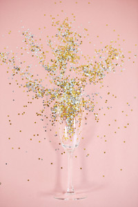 Champagne glass with full of confetti
