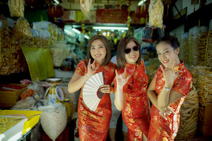cheerful asian woman wearing chinese tradition clothes toothy smiling face in bangkok china town