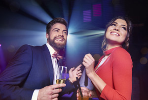 Cheerful couple with alcohol dancing