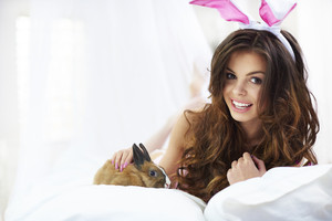 Cheerful sexy bunny in her bed