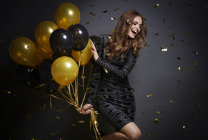 Cheerful woman with balloons laughing