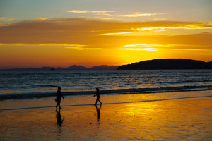 Children Walking At Beach During Sunset