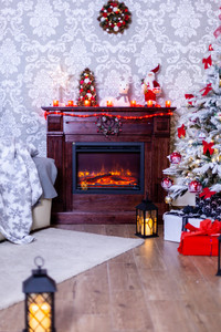 Christmas cozy interior with fireplace and christmas tree. Holiday