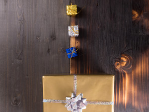 Christmas gift boxes on vintage wooden background. Winter is coming