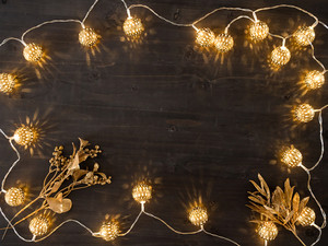 Christmaslights on wooden background. Beautiful christmas holiday decoration
