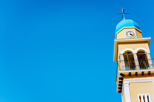 Church tower against blue sky on Kefalonia island, Greece