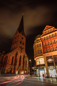 City view of Hamburg downtown at night. View of St. Petri church and traditional red brick buildings. Long exposure. Car light trails. Hamburg, Germany