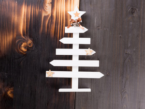 Classic christmas home decoration on wooden background. Handmade decoration