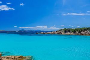 Clear amazing azure coloured sea water in Capriccioli beach, Sardinia, Italy