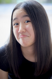 close up funny kidding face of asian teenager