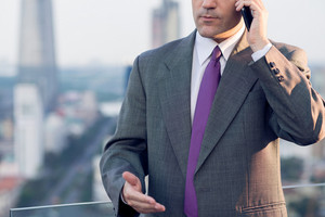 Close up image of a businessman talking by phone