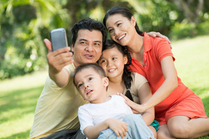 Close-up image of a friendly family making a photo of themselves