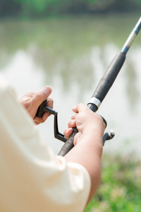 Close-up of a male hand holding fishing rod