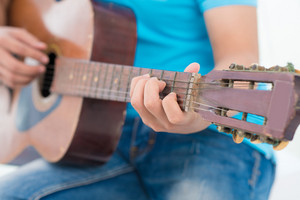 Close-up of a male hand playing the guitar