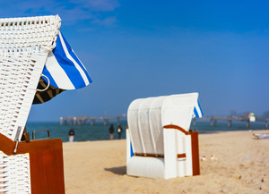 Close up of beach chairs on sandy beach on Travemuende, Luebeck Bay, Germany