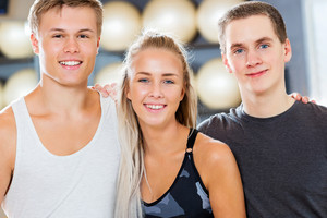 Close-up of Confident Male And Female Friends Smiling In Gym