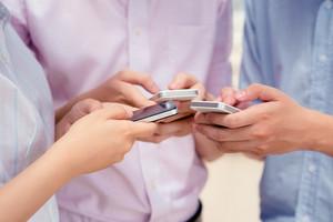 Close-up of hands using smartphones