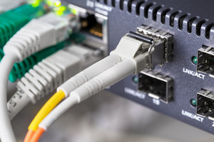 Close-up of high speed fiber network switch and cables in datacenter