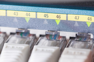 Close-up of high speed network switch and cables in datacenter