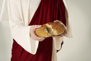 Close up of Jesus hands with bread of life