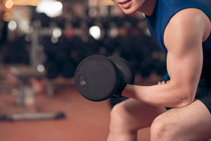 Close-up of man exercising with dumbbell
