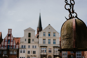 Close up of old Crane weight in front of historical building facade in Harbor Lueneburg, Lower Saxony,Germany
